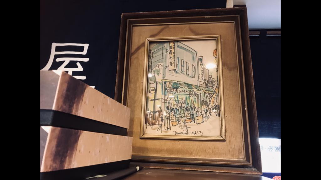 お店の外観が描かれた絵